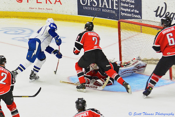 Syracuse Crunch Richard Panik (14) scores the overtime winning goal against the Portland Pirates in American Hockey League (AHL) Calder Cup playoff action at the Onondaga County War Memorial on Saturday, April 27, 2013 giving Syracuse a 4-3 overtime win.