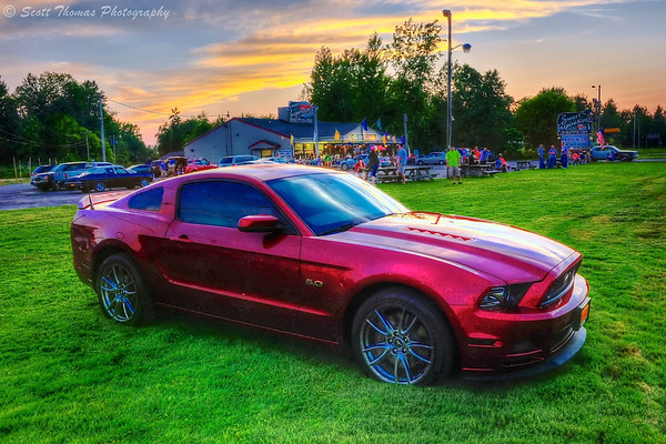 2013 Ford Mustang GT 5.0 taking part in a cruise in at Sweet Inspirations Drive-In near Fulton, New York.