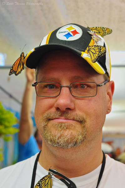 A visitor to the SkyRiver Butterfly exhibit at the New York State Fair in Syracuse, New York.