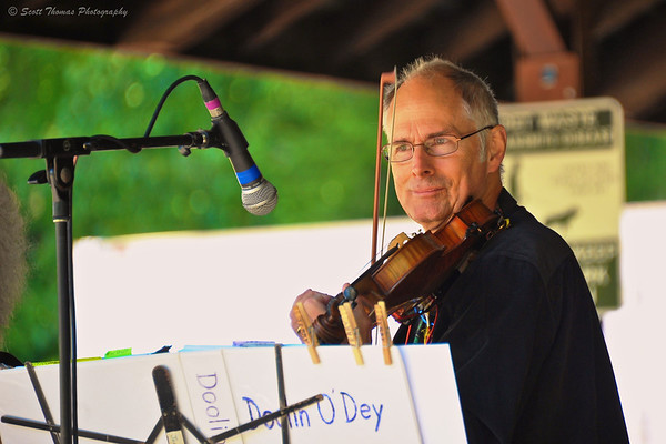 Fiddle player for Doolin O'Dey Jerry Drumhalle performing at the Cortland Celtic Festival at the Dwyer Memorial Park in Little York, New York.