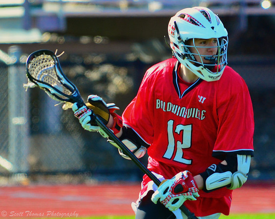 Baldwinsville Bees Connor Chapman (12) with the ball against the Marcellus Mustangs on Saturday, March 30, 2013.