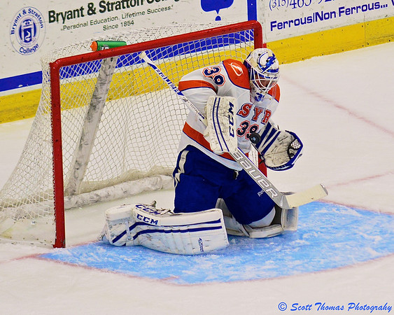 Syracuse Crunch goalie Anders Lindback (39) makes a save against the Wilkes-Barre/Scranton Penguins in American Hockey League (AHL) action at the War Memorial Arena on Friday, February 28, 2014. Syracuse won 4-0.