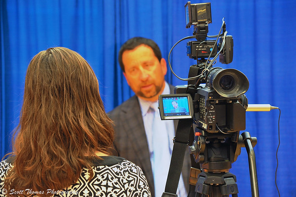 Syracuse Crunch owner Howard Dolgon talks to a television reporter after the press conference announcing the Frozen Dome Classic at the Carrier Dome on the Syracuse University campus in Syracuse, New York.