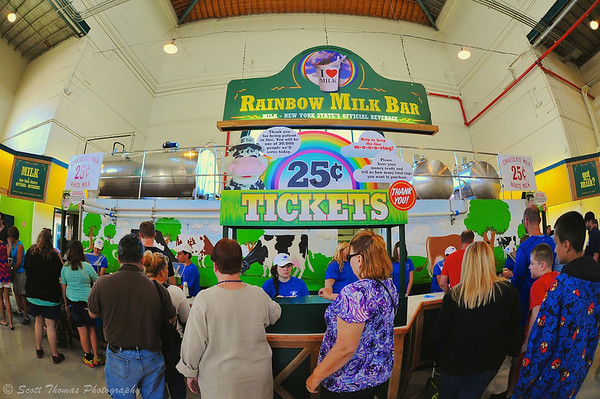 People waiting to get 25 cent cups of milk at the Rainbow Bar in the Dairy Building of the Great New York State Fair in Syracuse, New York.