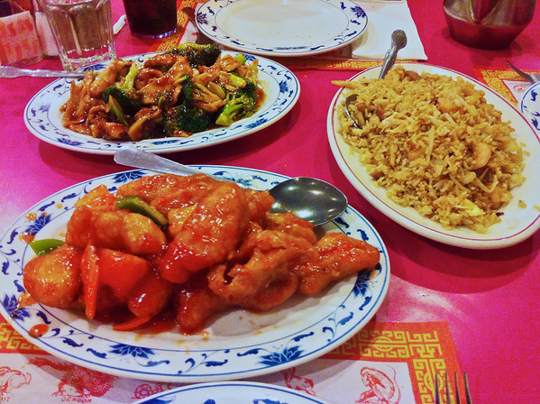 Chinese dishes from Eat First restaurant in Washington, DC. Sweet and Sour Chicken, House Special Fried Rice with chicken, beef, shrimp and Broccoli Chicken.