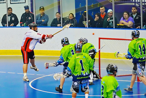 "Onondaga Redhawks Percy Shenandoah (19) scores over the Rochester Greywolves goalie at the Onondaga Nation Arena near Nedrow, New York on Saturday, April 28, 2012 in Can-Am Senior ""B"" Box Lacrosse game action."