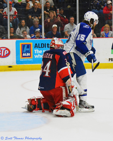 Syracuse Crunch J. T. Wyman (15) screens Grand Rapids Griffins goalie Petr Mrazek (34) as a shot by Crunch J. T. Brown (23) goes into the net in American Hockey League (AHL) Calder Cup Finals Playoff action at the Onondaga County War Memorial on Sunday, June 9, 2013. Grand Rapids won 6-4.
