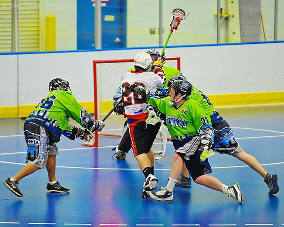 Onondaga Redhawks player bulls his way through defenders to score against the Rochester Greywolves at the Onondaga Nation Arena near Nedrow, New York.