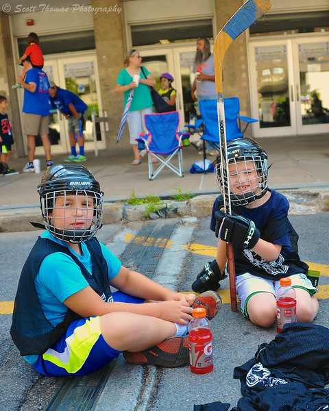 A couple of players hanging out between Street Crunch hockey shifts outside the War Memorial Arena in Syracuse, New York on Saturday, July 16, 2014.
