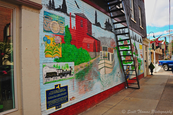 Baldwinsville 4 Corners Mural seen as a person walks north on Syracuse Street.