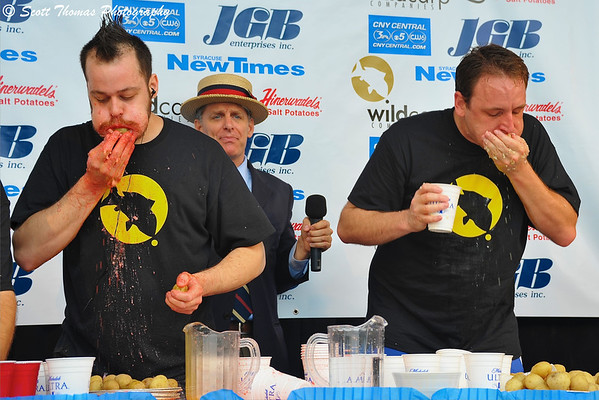 Pat Bertoletti (left) and Joey Chestnut (right) during the last minute of the Wild Carp Week World Salt Potato Eating Championship on Paper Mill Island Budweiser Amphitheater stage in Baldwinsville, New York.