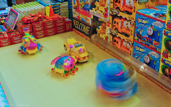 Toys move and spin at a vendors booth at the 13th annual Syracuse Nationals Car Show.