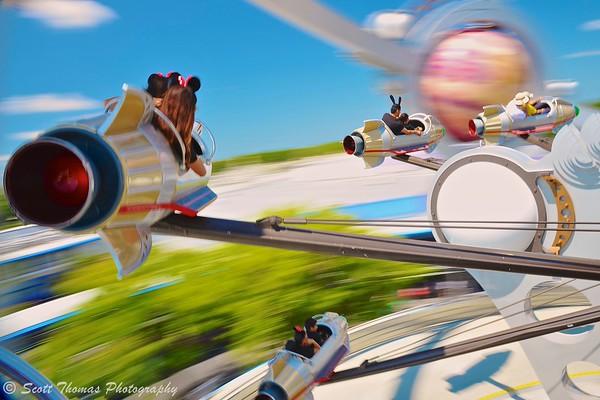 Riding the Astro Obiter in Tomorrowland at the Magic Kingdom, Walt Disney World, Orlando, Florida