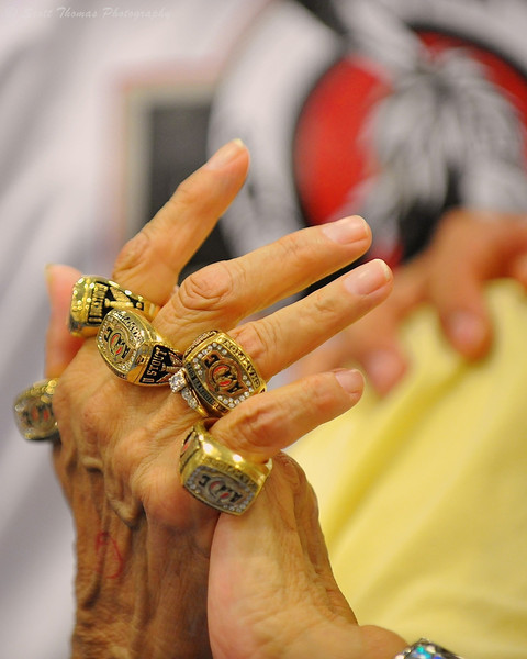 A grandmother's hand wearing her grandson's championship rings.