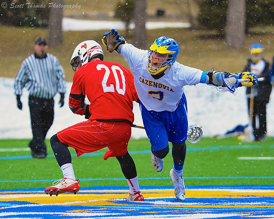 Cazenovia Lakers Henry Mann (2) wins the face-off to start the fourth quarter against Baldwinsville Bees Luke McCaffrey (20) on Saturday, April 5, 2015 at Cazenovia, New York.