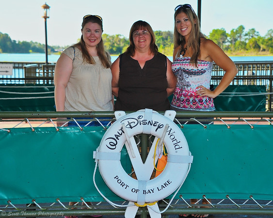 Members of a family getting ready to board a Motor Cruiser at the Magic Kingdom, Walt Disney World, Orlando, Florida.