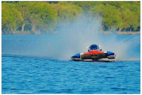 5.0 Liter Inboard Hydroplane flying down the front stretch at the HydroBowl on Seneca Lake in Geneva, New York.