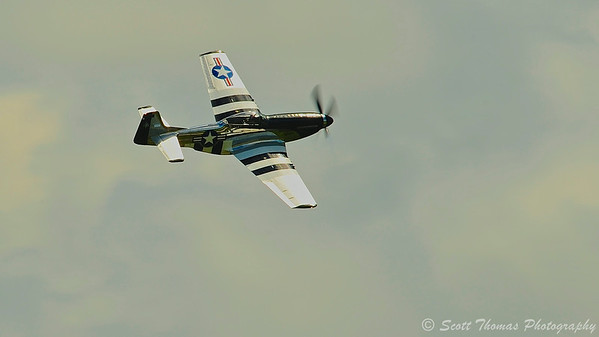 A P-51 Mustang called Quick Silver flying at the Kwik Fill Rochester International Airshow in Rochester, New York on Sunday, August 17, 2014.
