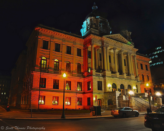 Onondaga County Courthouse in Syracuse, New York bathed in orange lighting in celebration of the Syracuse University Men's Basketball team making it to the NCAA Final Four Championship weekend in Atlanta, Georgia.