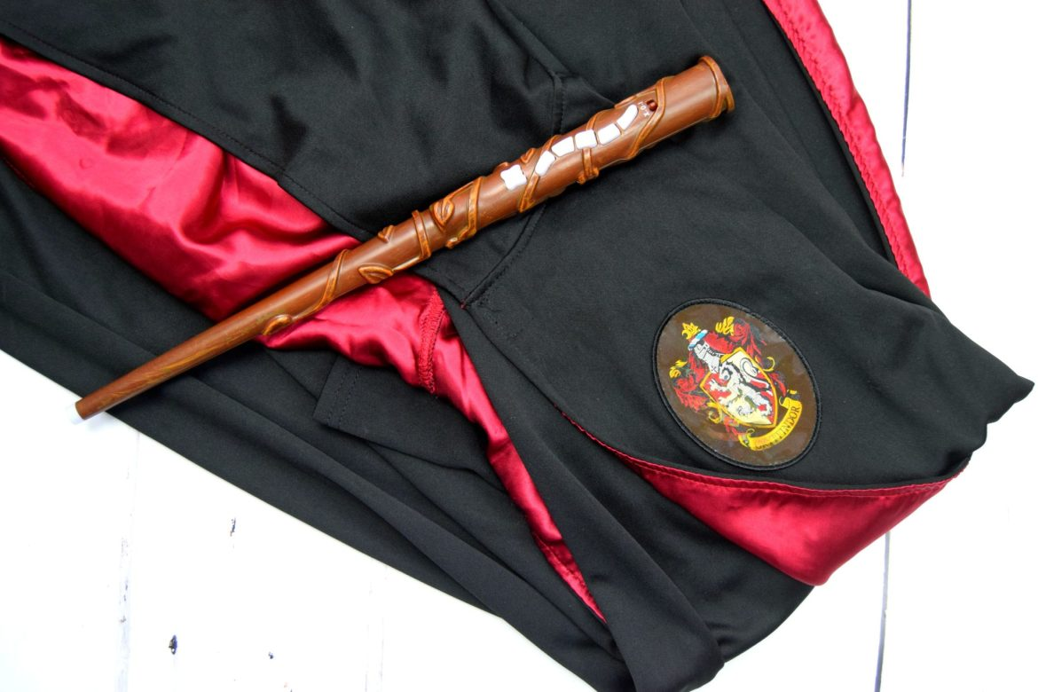Harry Potter toy wand and gryffindor magic gown costume.