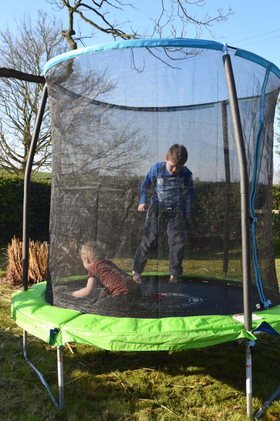 Playing outside on the trampoline. Home schooling activities