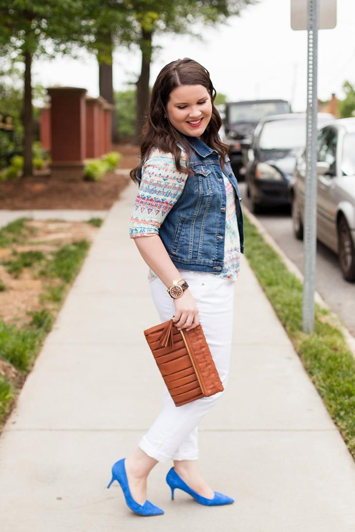 White boyfriend jeans, aztec printed top, denim vest, blue heels