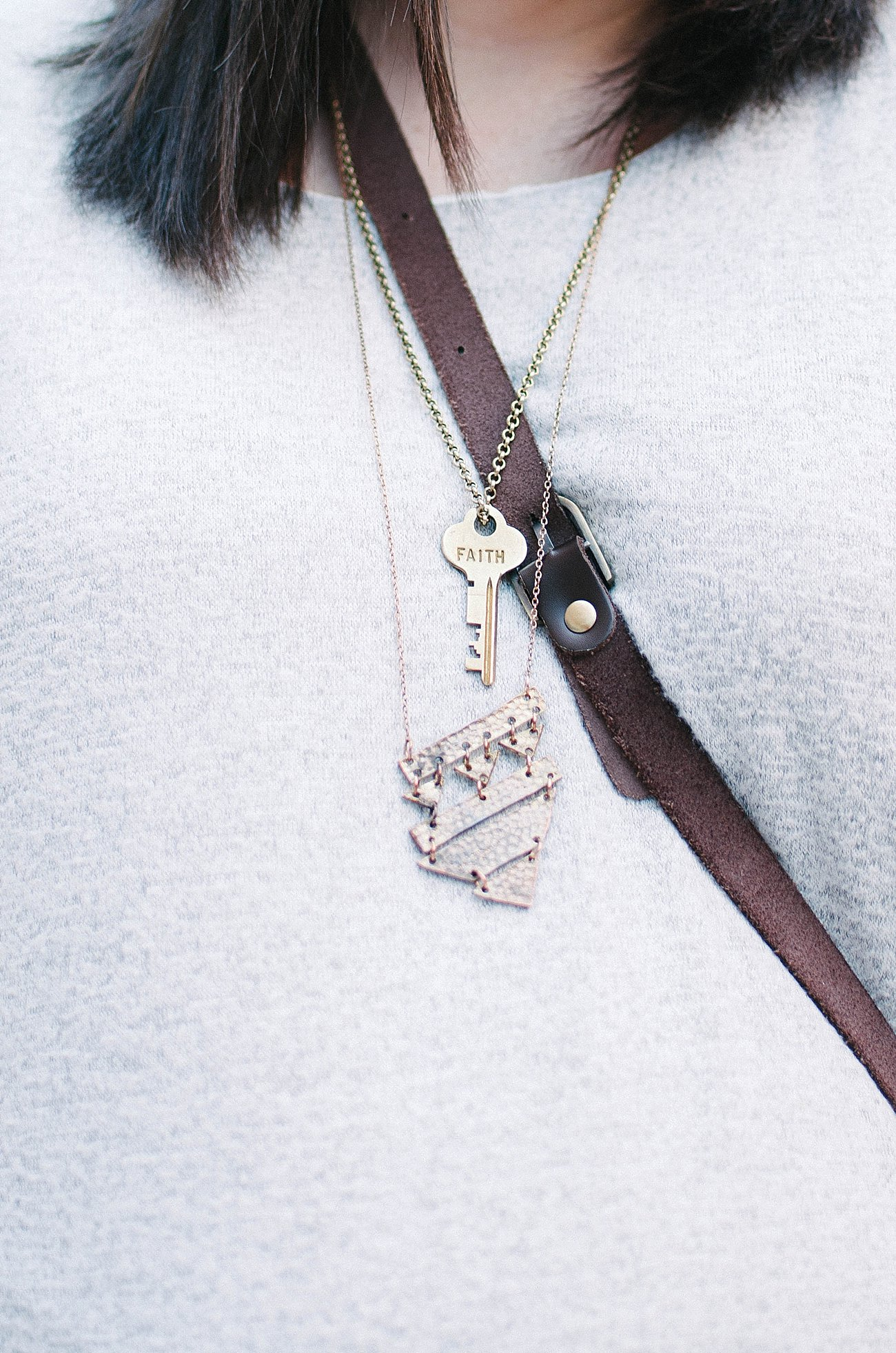 The Flourish Market / Mata Traders necklace and The Giving Keys necklace
