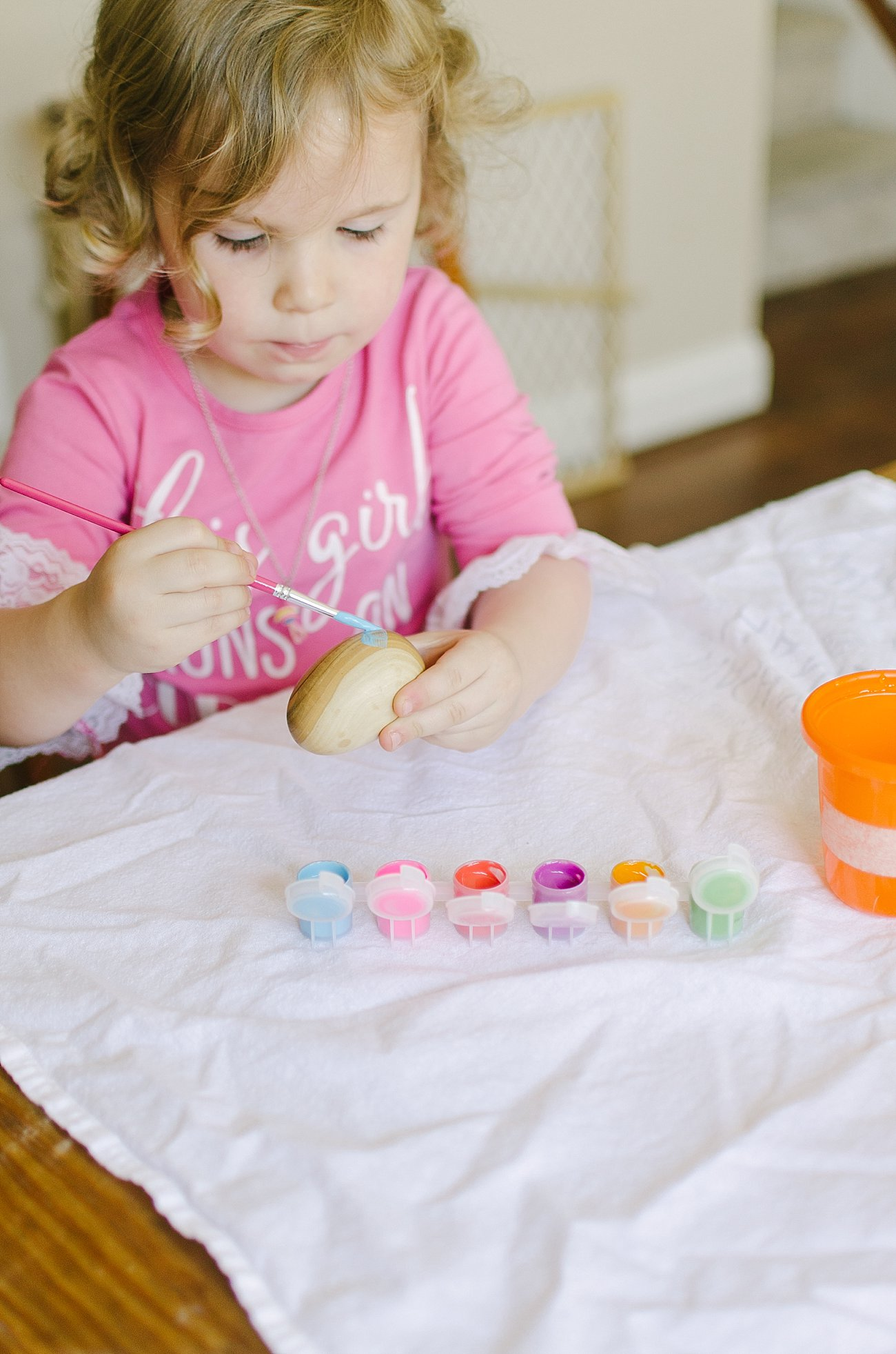Easter Traditions with Kids - Painting Handmade Wooden Easter Eggs by lifestyle blogger Still Being Molly