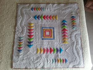 "I designed and quilted this quilt.  I am naming it ""Against All Odds""."