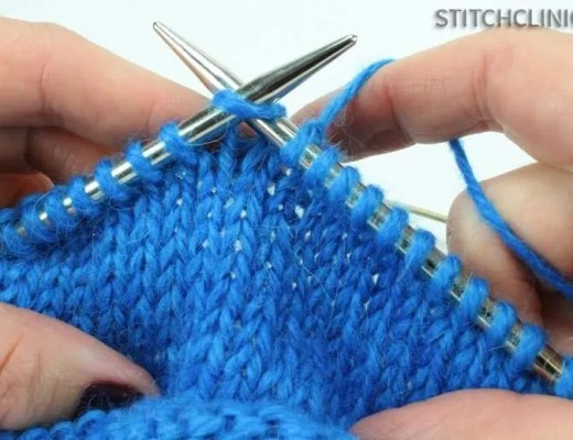 Showing how to do a knit stitch