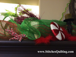 Grinch Decor Mantle Glittery Sprigs and Peppermint Candy. Here are more details of how we decorated the Glammed out Grinch Fireplace Mantle.