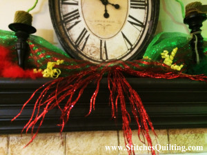 Grinch Decor Mantle Glittery Fanned Out Sprigs. Here are more details of how we decorated the Glammed out Grinch Fireplace Mantle.