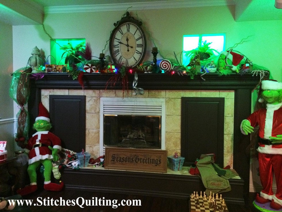 Let's Glam Grinch out our Christmas Fireplace Mantle! We even use green directional lighting!