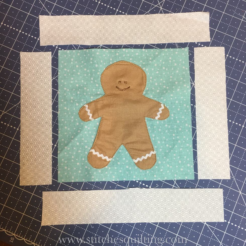 Let's add the sashing strips to the Cozy Christmas Gingerbread Man Block.