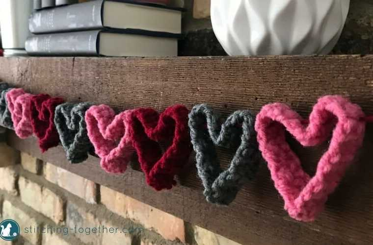 Get ready for Valentines Day with this adorable crochet heart garland. Perfect quick and easy way to DIY your Valentines Day decor. The garland would also make a cute decoration for a little girls room. | Free crochet pattern #ValentinesDaydecro #heartsgarland #crochethearts #freecrochetpattern