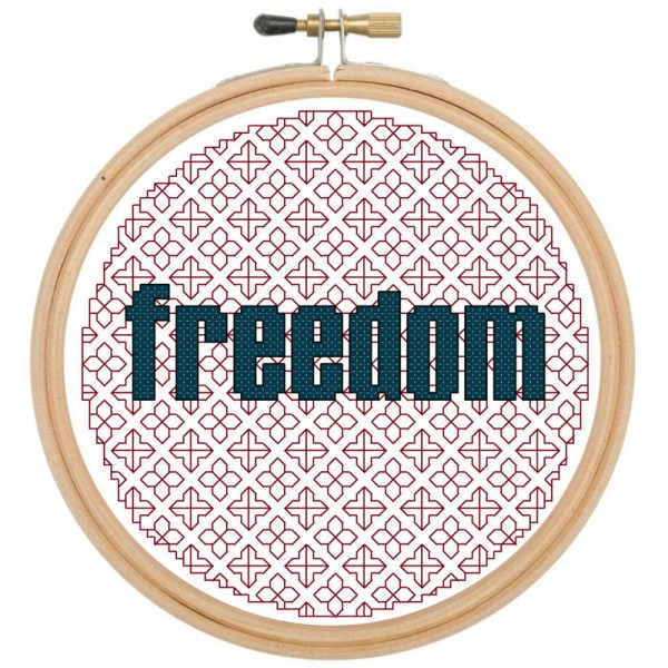 patriotic freedom cross stitch and blackwork pattern displayed in a wooden hoop