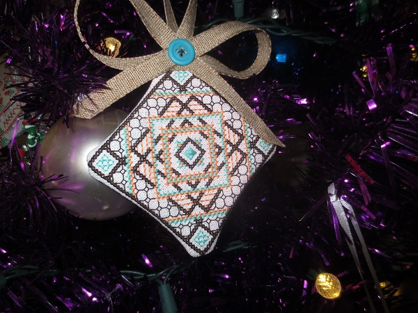Bella's Block Cross Stitch Ornament Finished and Displayed on Tree