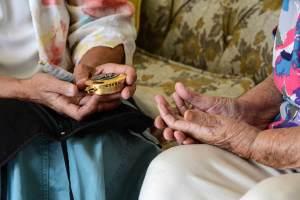 Sister Colleen Crossen's hands offering communion