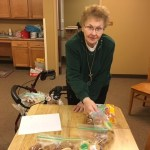Sister Anthony packs Christmas cookies for inmates of the Beaver County Jail.