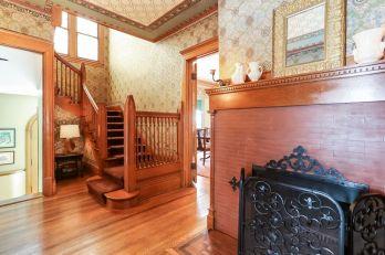 027_photo_wood_burning_fireplace_in_first_floor_foyerhallway_6719160
