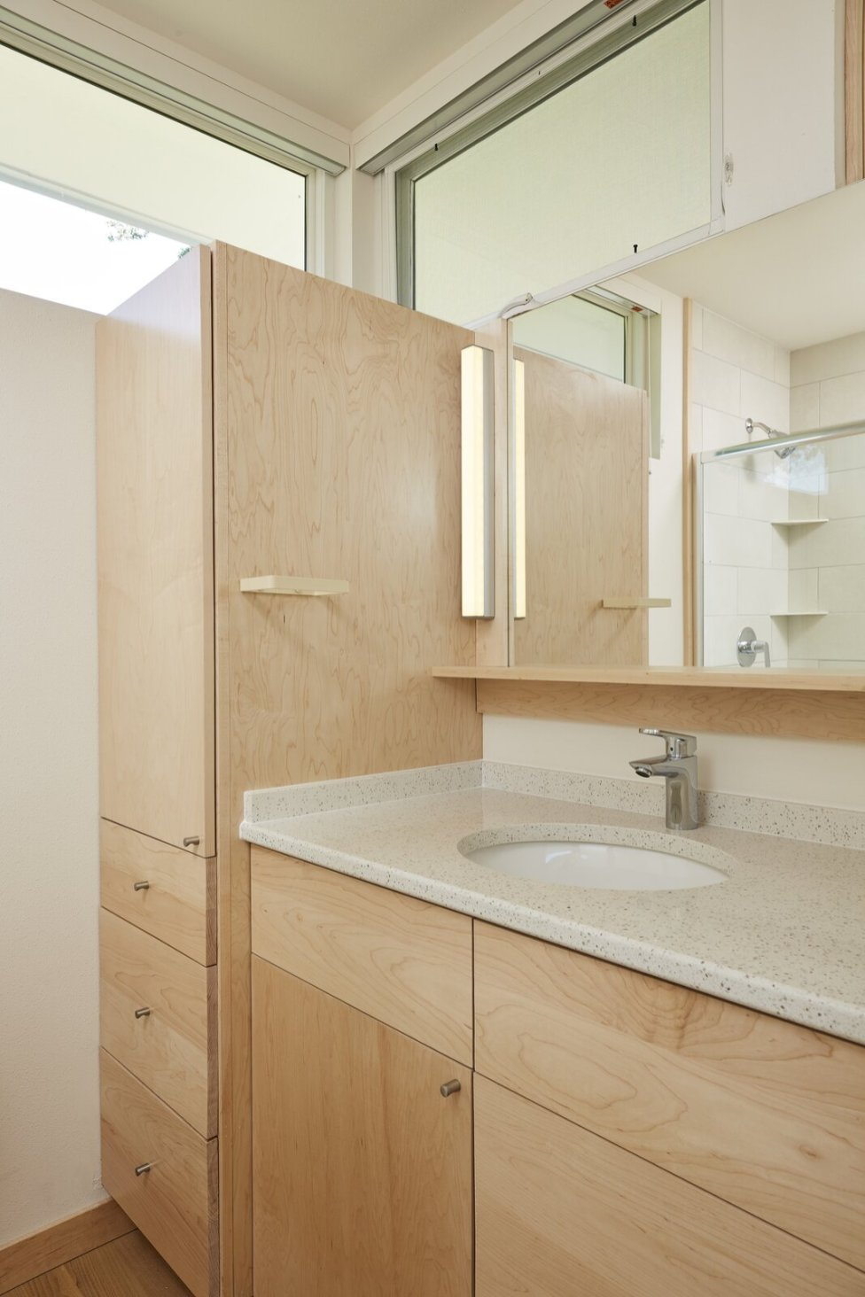 maple-cabinetry-in-the-main-bathroom-lends-warmth-and-texture