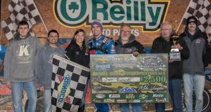 Josh Richards of Shinnston, WV celebrates with his crew after his first career NeSmith Chevrolet Dirt Late Model Series win on Friday night at Bubba Raceway Park in Ocala, FL driving the Sallack Well Service Rocket.  Richards took the lead on lap five, and then held off a strong challenge from Kyle Bronson of Brandon, FL to post the victory.  (NeSmith Media Photo by Bruce Carroll)