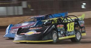 Chase Edge of LaFayette, AL drives his #18 Edge's Gas Company Special under Ryan Carter of Blackshear, GA in the #52 Mark's Auto and Collision Special to take the lead on the third lap of the 50-lap NeSmith Chevrolet Dirt Late Model Series RockAuto.com Winter Shootout race Friday night at Golden Isles Speedway in Brunswick, GA in the Super Bowl of Racing.  Edge led the rest of the way to the checkered flag to collect the $2,500 top prize.  (NeSmith Media Photo by Bruce Carroll)