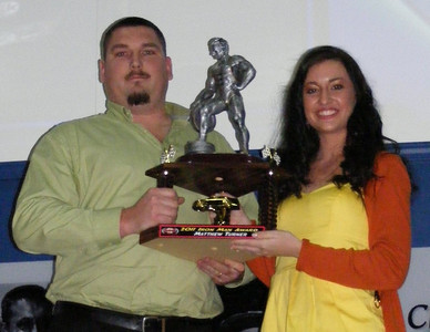 Matthew Turner of Dawsonville, GA receives the Ironman Award to commemorate his 124 consecutive races from Trophy Presenter Amber Lee during the NeSmith Chevrolet Dirt Late Model Series Awards Banquet on Saturday night at the Georgia Racing Hall of Fame and Thunder Road USA Museum in Dawsonville, GA.  (Angela Williamson Photo)