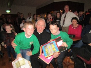 Our P3 & P4 pupils presented Fr Kerr with a very special scrapbook which they created over the past few weeks. It included their special memories of him, pictures they drew, photographs and much more.