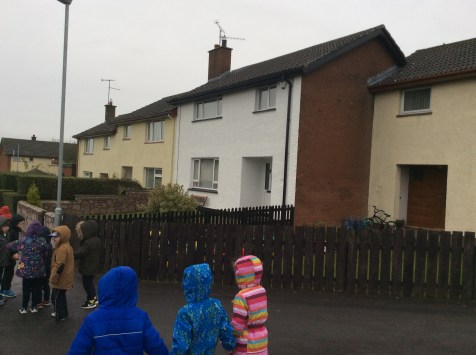 Yesterday we took a walk around our local area. Pat was able to tell us lots of interesting things about some of the buildings. Today some of us painted the road and grass areas and we planned where to position the photographs Mrs Nugent took in order to create a map of the area around our school.