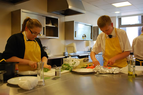 Pupils cooking during Masterchef cook-offs