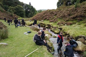 Geography pupils in the river during their Edale trip