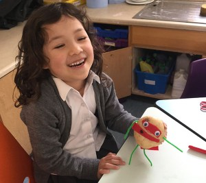 Reception pupil with Supertato