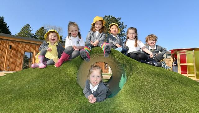 Nursery pupils playing outside